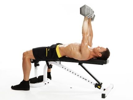 A man exercising with dumbbells
