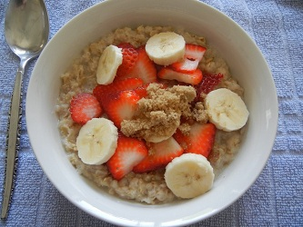 healthy breakfast - oatmeal with banana and strawberry