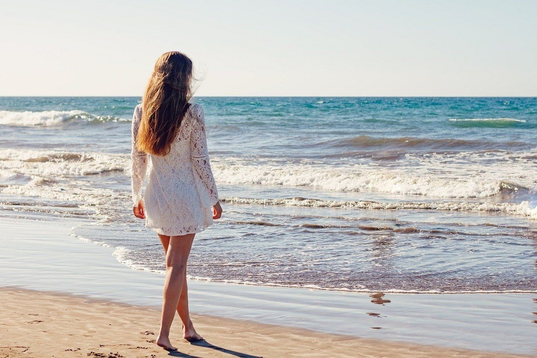 young-woman-beach-sand